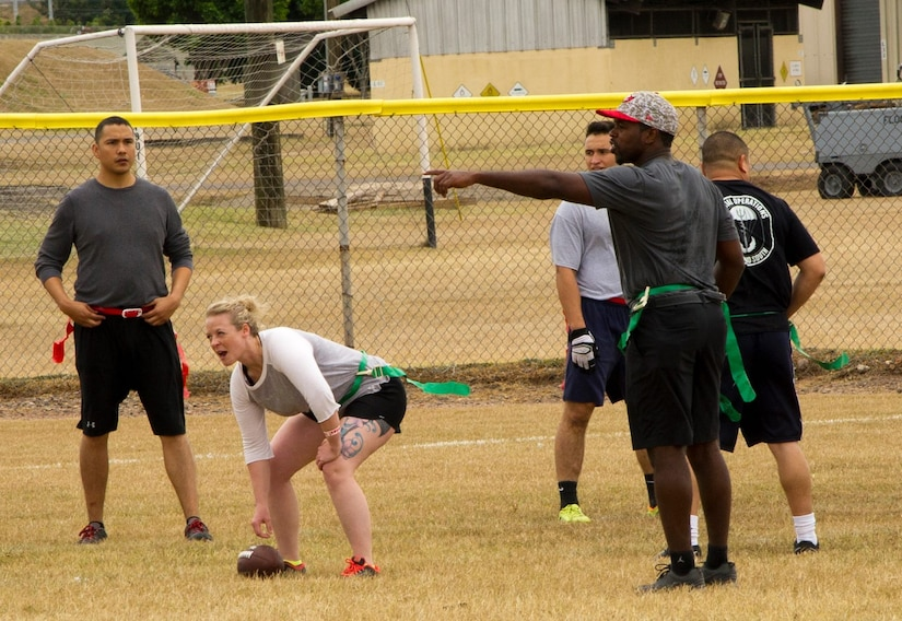 Pictured right, Keith Tandy, Tampa Bay Buccaneers safety, plays a game of flag football with Servicemembers Feb. 6, 2016 at Soto Cano Air Base, Honduras, as a part of a visit to the base hosted by the Armed Forces Entertainment organization for Super Bowl 50. (U.S. Air Force photo by Capt. Christopher Mesnard/Released)