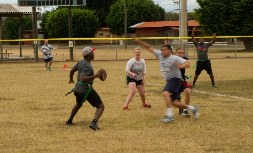 Pictured left, Keith Tandy, Tampa Bay Buccaneers safety, plays a game of flag football with Servicemembers Feb. 6, 2016 at Soto Cano Air Base, Honduras, as a part of a visit to the base hosted by the Armed Forces Entertainment organization for Super Bowl 50. (U.S. Air Force photo by Capt. Christopher Mesnard/Released)