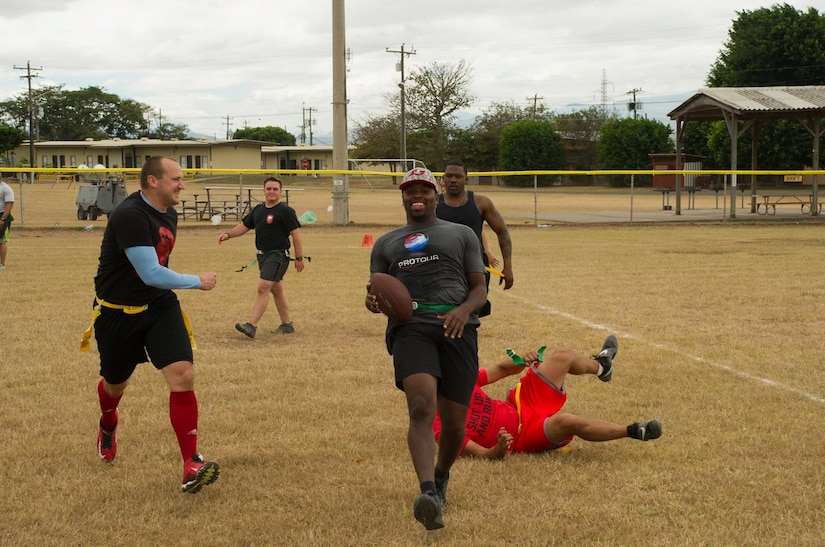 Pictured center, Keith Tandy, Tampa Bay Buccaneers safety, is downed during a game of flag football by a member of the Army Forces Battalion Feb. 6, 2016 at Soto Cano Air Base, Honduras, as a part of a visit to the base hosted by the Armed Forces Entertainment for Super Bowl 50. (U.S. Air Force photo by Capt. Christopher Mesnard/Released)