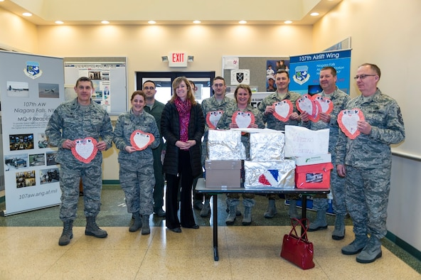 Airmen from the 107th Airlift Wing, Niagara Falls Air Reserve Station, N.Y., receive Valentine's Day cards here from Lynne Dixon, an Erie County legislator, Feb. 10, 2016. Dixon presented the cards on behalf of children from more than 35 Erie County schools, as part of a program that is in its seventh year. (U.S. Air National Guard photo by Staff Sgt. Ryan Campbell/Released)
