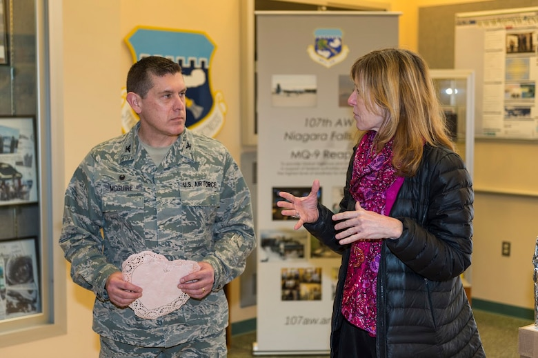 Lynne Dixon, an Erie County legislator, talks to the Airmen of the 107th Airlift Wing, Niagara Falls Air Reserve Station, N.Y., after delivering handmade Valentine's Day cards here, Feb. 10, 2016. The cards were made by children from more than 35 Erie County schools. (U.S. Air National Guard photo by Staff Sgt. Ryan Campbell/Released)