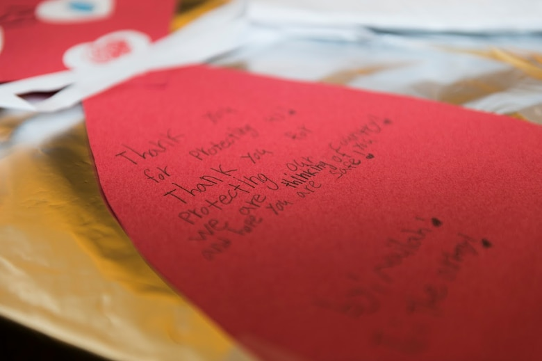 Airmen from the 107th Airlift Wing, Niagara Falls Air Reserve Station, turned out to receive handmade Valentine's Day cards here from Lynne Dixon, an Erie County legislator, Feb. 10, 2016. The cards were made my children from more than 35 Erie County schools. (U.S. Air National Guard photo by Staff Sgt. Ryan Campbell/Released)
