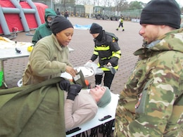 Capt. Shawnda Bass, a Registered Nurse with the 773rd Civil Support Team, evaluated a casualty after a simulated chemical spill during exercise Ocean Response Feb. 11, 2016 at Rhine Ordnance Barracks in Germany. The 773rd trained along with members of the Spanish Unidad Militar de Emergencias and the Slovenian army during the exercise. (Photo by Lt. Col. Jefferson Wolfe, 7th Mission Support Command public affairs office)