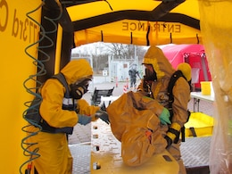 Members of the 773rd Civil Support Team wash and decontaminate the victim of a simulated chemical spill during exercise Ocean Response Wednesday, Feb. 11, 2016 at Rhine Ordnance Barracks in Germany. The 773rd trained along with members of the Spanish Unidad Militar de Emergencias and the Slovenian army during the exercise. (Photo by Lt. Col. Jefferson Wolfe, 7th Mission Support Command public affairs office)
