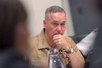 Marine Gen. Joseph F. Dunford Jr., chairman of the Joint Chiefs of Staff, listens to an interpreter during a trilateral meeting with military leaders from the Republic of Korea and Japan in Hawaii, Feb. 10, 2016. The session featured discussions on information sharing and collaboration in light of the increasing North Korean nuclear and missile threats. DoD photo by Navy Petty Officer 2nd Class Dominique A. Pineiro