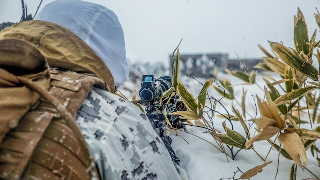 A U.S. Marine provides security and overwatch for Marines conducting urban operations during Forest Light 16-2 in Yausubetsu Training Area, Hokkaido, Japan, Jan. 28, 2016. The Japan and U.S. forces demonstrated each other's tactics for securing the area around an enemy urban zone and breaching the urban area. The exercise strengthens military partnership, solidifies regional security agreements and improves individual and unit-level skills. The JGSDF soldiers are with the 27th Infantry Regiment, 5th Brigade, Northern Army. The Marines are with Kilo Company, 3rd Battalion, 5th Marine Regiment currently assigned to 4th Marine Regiment, 3rd Marine Division, III Marine Expeditionary Force.