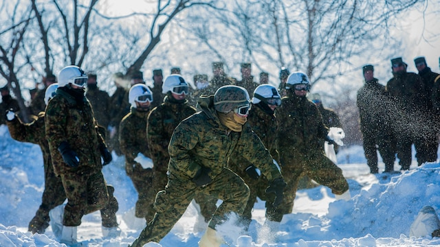 U.S. Marines and Japan Ground Self-Defense Force soldiers use cover to throw snowballs during a snowball fight championship for Forest Light 16-2 in Yausubetsu Training Area, Hokkaido, Japan, Jan. 31, 2016. Forest Light, a semi-annual exercise between the JGSDF and III Marine Expeditionary Force, strengthens military partnership, solidifies regional security agreements and improves individual and unit-level skills. The JGSDF soldiers are with the 27th Infantry Regiment, 5th Brigade, Northern Army. The Marines are with 3rd Battalion, 5th Marine Regiment currently assigned to 4th Marine Regiment, 3rd Marine Division, III MEF through the unit deployment program.