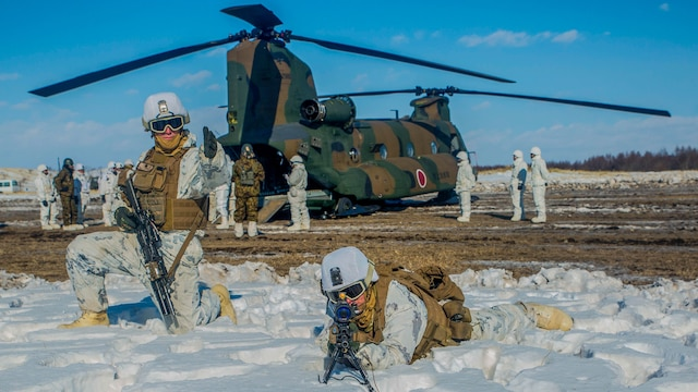 U.S. Marines provide security for a Japan Ground Self Defense Force CH-47 Chinook during Forest Light 16-2 in Yausubetsu Training Area, Hokkaido, Japan, Feb. 1, 2016. The exercise strengthens military partnership, solidifies regional security agreements and improves individual and unit-level skills. The JGSDF soldiers are with the 103 Helicopter Brigade, Northern Army. The Marines are with Kilo Company, 3rd Battalion, 5th Marine Regiment currently assigned to 4th Marine Regiment, 3rd Marine Division, III Marine Expeditionary Force.