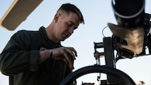 "Sgt. Benjamin Hebert, a crew chief with Marine Light Attack Helicopter Squadron 469 based out of Marine Corps Air Station Camp Pendleton, Calif., performs maintenance on a UH-1Y ""Venom"" helicopter aboard Marine Corps Air Station Yuma, Ariz., Friday, Feb. 5, 2016."