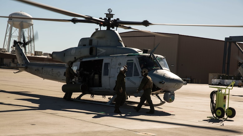 "Marines with Marine Light Attack Helicopter Squadron 469, based out of Marine Corps Air Station Camp Pendleton, Calif., perform pre-flight inspections on a UH-1Y ""Venom"" aboard Marine Corps Air Station Yuma, Ariz., Friday, Feb. 5, 2016."