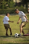U.S. Marines with Combat Logistics Battalion 3 (CLB3), play soccer with the students at Ban Phromnimit School, in Wang Yeng Nam, during exercise Cobra Gold, Feb. 5, 2016. Cobra Gold 2016, in its 35th iteration, includes a specific focus on humanitarian civic action, community engagement, and medical activities conducted during the exercise to support the needs and humanitarian interests of civilian populations around the region.