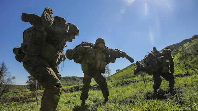 Marines perform buddy carries and other types of physical training during a combat endurance challenge at Marine Corps Base Camp Pendleton, Calif. Feb. 5, 2016. The challenge consisted of hiking nearly seven miles, testing weapons systems, combat lifesaving skills, land navigation and simulated casualty evacuation. The Marines with Battery Q, 5th Battalion, 11th Marine Regiment conducted the training aboard MCB Camp Pendleton.