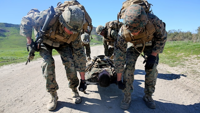 Marines evacuate a simulated casualty during a combat endurance challenge Marine Corps Base Camp Pendleton, Calif.Feb. 5, 2016. The challenge consisted of hiking nearly seven miles, testing weapons systems, combat lifesaving skills, land navigation and simulated casualty evacuation. The Marines with Battery Q, 5th Battalion, 11th Marine Regiment conducted the training aboard MCB Camp Pendleton.