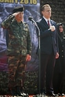 Royal Thai Army Supreme Commander, Gen. Sommai Kaotira and U.S. Ambassador Glyn Davies (right), salute to the U.S. and Thailand national anthems during the opening ceremony for Exercise Cobra Gold at the Royal Thai Marine Corps Headquarters in Sattahip, Thailand, Feb. 9, 2016. Cobra Gold will consist of three primary events: a command post exercise, which includes a senior leader seminar; humanitarian civic assistance projects in Thai communities; and a field training exercise that will build regional relationships.