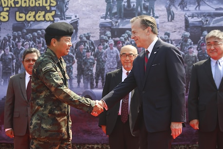 Royal Thai Army Supreme Commander, Gen. Sommai Kaotira and U.S. Ambassador Glyn Davies (right),  shake hands during the opening ceremony for Exercise Cobra Gold at the Royal Thai Marine Corps Headquarters in Sattahip, Thailand, Feb. 9, 2016. Cobra Gold will consist of three primary events: a command post exercise, which includes a senior leader seminar; humanitarian civic assistance projects in Thai communities; and a field training exercise that will build regional relationships.
