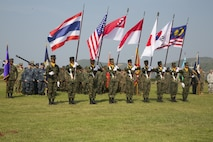 Multinational service members stand in formation during the opening ceremony for Exercise Cobra Gold at the Royal Thai Marine Corps Headquarters in Sattahip, Thailand, Feb. 9, 2016. Cobra Gold will consist of three primary events: a command post exercise, which includes a senior leader seminar; humanitarian civic assistance projects in Thai communities; and a field training exercise that will build regional relationships. (U.S. Marine Corps photo by Lance Cpl. Jeremy L. Laboy/Released)