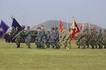Multinational service members march in formation during the opening ceremony for Exercise Cobra Gold at the Royal Thai Marine Corps Headquarters in Sattahip, Thailand, Feb. 9, 2016. Cobra Gold will consist of three primary events: a command post exercise, which includes a senior leader seminar; humanitarian civic assistance projects in Thai communities; and a field training exercise that will build regional relationships.