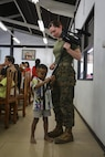 U.S. Marine Corps Lance Cpl. Megan Boulrice, combat videographer with U.S. Marine Corps Forces, Pacific, plays with a child at the Child Development and Protection Center, in Chonburi, Thailand, during exercise Cobra Gold, Feb. 6, 2016. Cobra Gold 2016, in its 35th iteration includes a specific focus on Humanitarian Civic Action, community engagement, and medical activities conducted during the exercise to support the needs and humanitarian interests of civilian populations around the region.