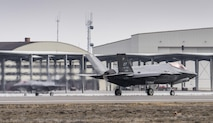 Two F-35A Lightning IIs taxi after landing at Mountain Home Air Force Base, Idaho, Feb. 8, 2016. The F-35s, from Edwards AFB, Calif., will be part of an initial operating capability test at the nearby range complex. (U.S. Air Force photo/Tech. Sgt. Samuel Morse)