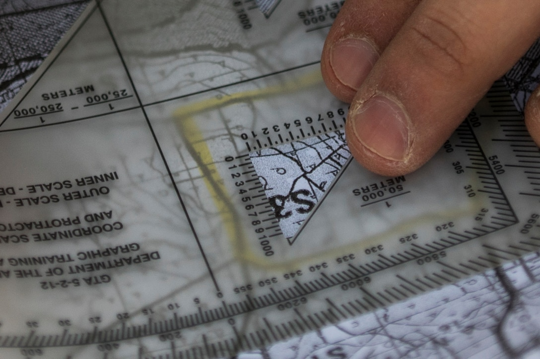 A U.S. Army Reserve miilitary police Soldier plots a grid coordinate on a map during a land navigation course in this year's 200th Military Police Command's Best Warrior Competition held at Camp Blanding, Fla., Feb. 9. The winning noncommissioned officer and junior enlisted Soldiers will move on to the U.S. Army Reserve Command competition in May. (U.S. Army photo by Master Sgt. Michel Sauret)