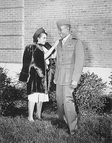 """""""The first Negro to be commissioned in the Marine Corps has his second lieutenant's bars pinned on by his wife. He is Frederick C. Branch of Charlotte, NC."""","""