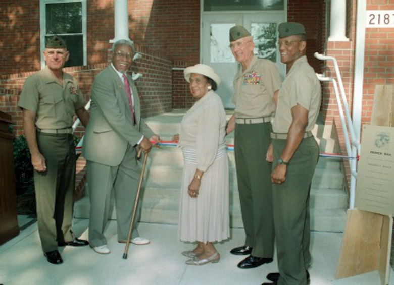 Mr. Frederick Clinton Branch cuts the ribbon and officially dedicates Branch Hall at the Officer Candidates School. Assisting Mr. Branch are his wife; Brig. Gen. E. C. Kelly (left), Lt. Gen. P. K. Van Riper and Col. A. David. Photo taken July 9, 1997.