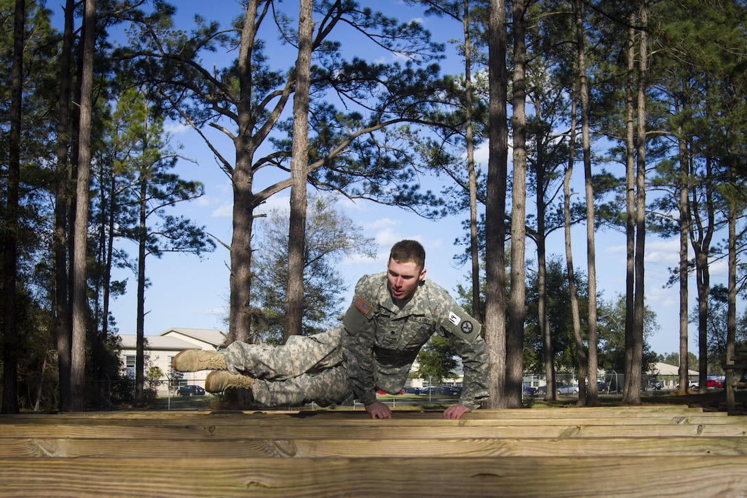 Spc. Keith Mundorff, a U.S. Army Reserve corrections specialist from Hanover, Pennsylvania, assigned to the 317th Military Police Battalion, clears hurtles during an obstacle course at this year's 200th  Military Police Command's Best Warrior Competition held at Camp Blanding, Florida, Feb 9. The winning noncommissioned officer and junior enlisted Soldiers will move on the U.S. Army Reserve Command competition in May. (U.S. Army Photo by Sgt. Audrey Ann Hayes)