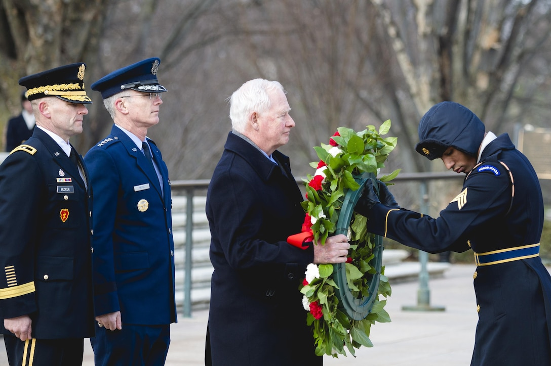 Canadian Governor General  David Johnston lays a wreath as Air Force Gen. Paul J. Selva looks on at the Tomb of the Unknown Soldier at Arlington National Cemetery in Arlington, Va., Feb. 10, 2016. Johnston also placed a wreath at the Canadian Cross of Sacrifice during his cemetery visit, honoring Canadian troops who served with U.S. forces. DoD photo by Army Staff Sgt. Sean K. Harp