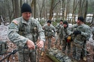 U.S. Army Sgt. 1st Class, Shane Frackell, a military mountaineering instructor assigned to 5th Ranger Training Battalion, demonstrates building a rope system to students during Basic Military Mountaineering Course at Camp Frank D. Merrill, Dahlonega, Ga., Jan. 21, 2016. The Basic Military Mountaineering Course trains Soldiers in the fundamental knowledge/skills required to successfully conduct small unit operations in mountainous terrain found throughout the world.(U.S. Army photo by Staff Sgt. Alex Manne/Released)