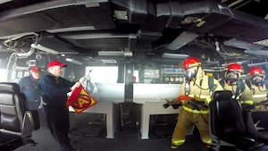 AT SEA ABOARD USS CORONADO (Jan. 25, 2016) - Coronado Crew 206 hose team engages a simulated Class A fire in the Integrated Command Center (ICC) 1, as expert TSST Implementers simulate the progression of the fire and white smoke. USS Coronado (LCS 4) successfully completed the Navy's Total Ship Survivability Trial (TSST) Jan. 28. (U.S. Navy photo/Released)