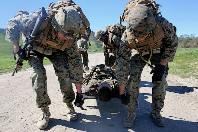 Marines evacuate a simulated casualty during combat endurance challenge on Marine Corp Base Camp Pendleton, Feb. 5, 2016. Marines hiked nearly seven miles, testing weapons systems, combat lifesaving skills, land navigation and simulated casualty evacuation. Marine Corps photo by Pvt. Robert Bliss