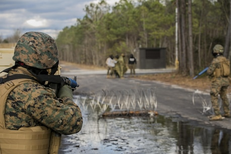Marines with 2nd Law Enforcement Battalion confront -rock-throwing hostiles at Camp Lejeune, N.C., Feb. 9, 2016. This kind of training allows 2nd LEB to develop and practice all the capabilities that the unit brings to the Marine Expeditionary Unit. The obstacles that they faced included rugged environments, improvised explosive devices and ambushes by the enemy. (U.S. Marine Corps photo by Lance Cpl. Luke Hoogendam/Released)