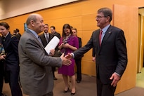 Defense Secretary Ash Carter, right, greets the French Defense Minister Jean-Yves Le Drian as they meet at NATO headquarters in Brussels, Feb. 11, 2016, to discuss matters of mutual importance. DoD photo by Air Force Senior Master Sgt. Adrian Cadiz