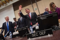 Defense Secretary Ash Carter waves hello as he arrives for a meeting at NATO headquarters in Brussels, Feb. 11, 2016, to discuss accelerating the fight against the Islamic State of Iraq and the Levant.  DoD photo by Air Force Senior Master Sgt. Adrian Cadiz