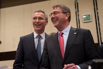 Defense Secretary Ash Carter shares a light moment with NATO Secretary General Jens Stoltenberg as Carter arrives for a meeting at NATO headquarters in Brussels. Feb. 11, 2016, to discuss accelerating the fight against the Islamic State of Iraq and the Levant. DoD photo by Air Force Senior Master Sgt. Adrian Cadiz