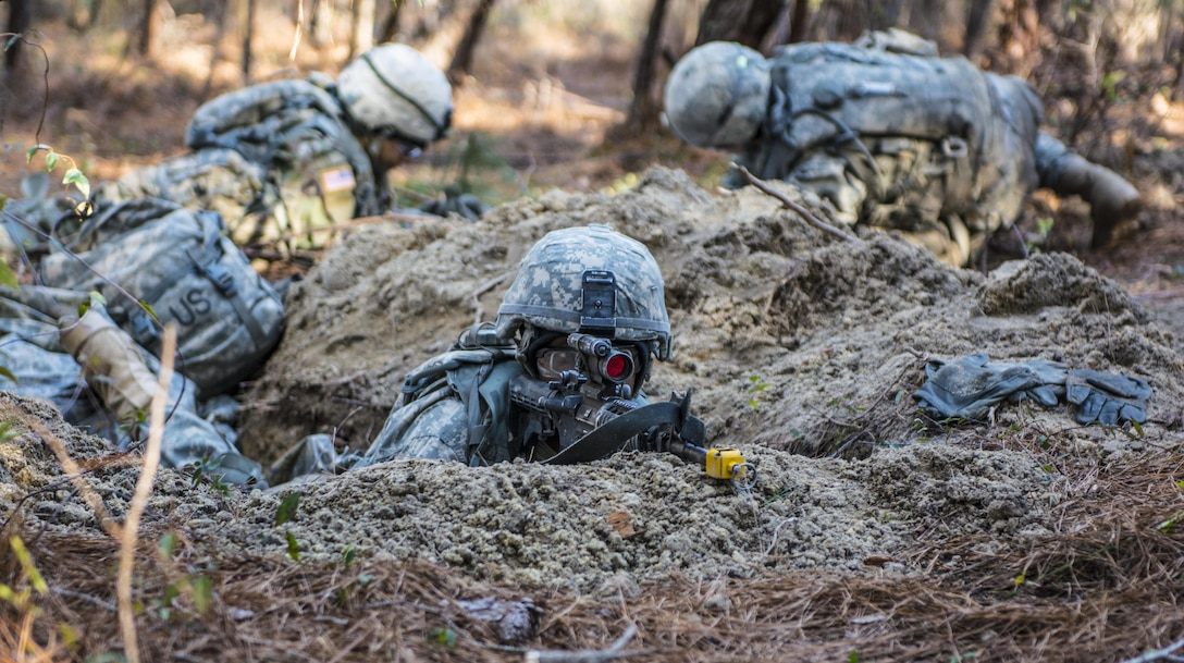 A Soldier in Basic Combat Training with C Company, 1st Battalion, 61st Infantry Regiment, provides security as his battle buddies improve their fighting positions at the Victory Forge field training exercise on Fort Jackson, S.C., Feb. 10, 2016. Victory Forge is the culminating exercise for all Soldiers in basic combat training at Fort Jackson. (U.S. Army photo by Sgt. 1st Class Brian Hamilton)
