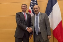 Defense Secretary Ash Carter, left, greets the French Defense Minister Jean-Yves Le Drian as they meet at NATO headquarters in Brussels, Feb. 11, 2016. DoD photo by U.S. Air Force Senior Master Sgt. Adrian Cadiz