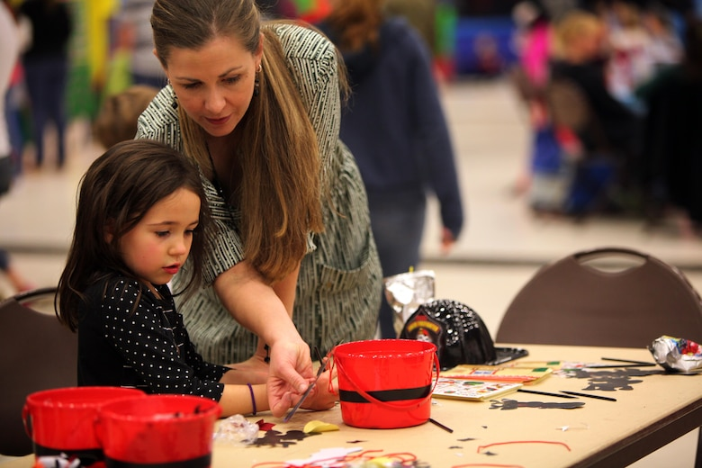 Michelle Moll and Ella M. decorate reindeers during the 7th annual Winter Wonderland at Marine Corps Air Station Cherry Point, N.C., Dec. 11, 2015. More than 700 Marines, Sailors and family members participate in the event. Winter Wonderland was hosted by Marine Aircraft Group 14 to foster camaraderie and increase esprit de corps within MAG-14 subordinate commands.
