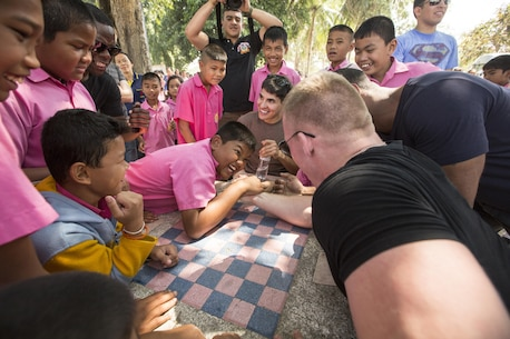 U.S. Marine Corps Cpl. Nicholas Emerson, an administration specialist with Marine Wing Headquarter Squadron 1, a native of Temecula, Calif., plays with children at the Wat Sombun Naram School, Rayong District, Thailand, during exercise Cobra Gold, Feb. 10, 2016. Cobra Gold, in its 35th iteration, includes a specific focus on humanitarian civic action, community engagement, and medical activities conducted during the exercise to support the needs and humanitarian interests of civilian populations around the region.