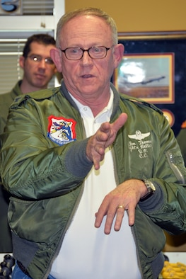 Retired U.S. Air Force Col. Jim Thomas, 55th Wing Association president, talks to Airmen about his experiences with the 55th Wing during a heritage event at the 97th Intelligence Squadron Feb. 5. The event was the first in a series of events that will lead up to the 55th Wing Birthday Ball May 21. (U.S. Air Force photo by Kendra Williams)