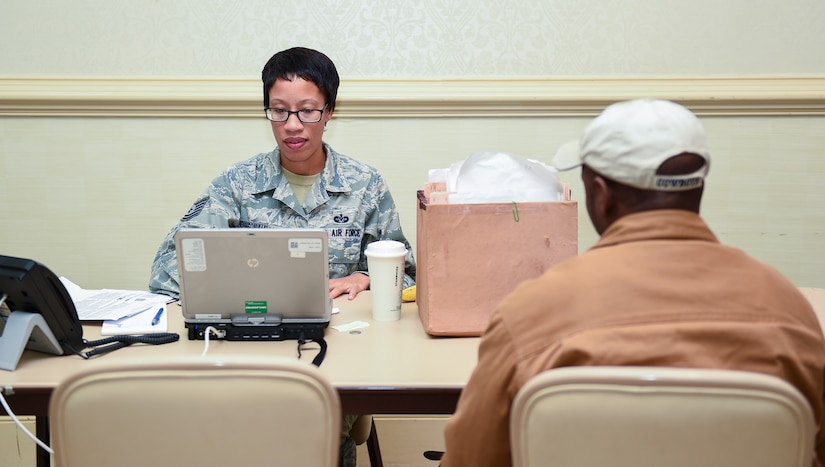 Tech. Sgt. Latoya Johnson-Mallory, 628th Legal Office paralegal, assists Joint Base Charleston members with their tax returns Feb. 9, 2016, at the Charleston Club on JB Charleston – Air Base, S.C. The Airmen working the tax center are able to provide tax return assistance to all active-duty, retirees and their dependents. (U.S. Air Force photo/Senior Airman Clayton Cupit)