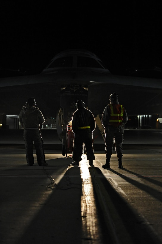 U.S. Air Force Senior Airman Michael Saulsberry, (left to right), Senior Airman Detroy Brooks, and Airman First Class Andrew Dutton, 509th Aircraft Maintenance Squadron crew chiefs, perform final inspection on a B-2 Spirit at Whiteman Air Force Base, Mo., Feb. 2, 2016, prior to take off during Red Flag (RF) 16-1. RF, based out of Nellis AFB, Nev., allows participating units to exchange tactics, techniques and procedures as well as improve interoperability. (U.S. Air Force photo by Tech. Sgt. Miguel Lara III)