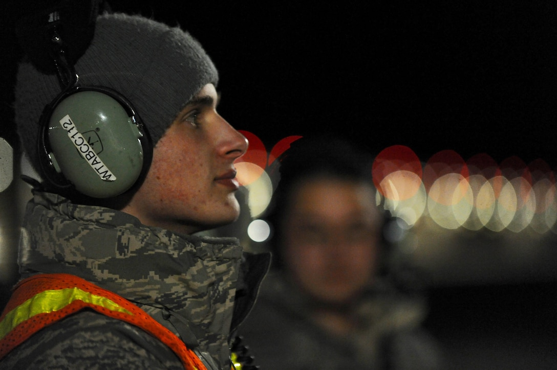 U.S. Air Force Airman 1st Class Andrew Dutton, a 509th Aircraft Maintenance Squadron crew chief, waits for pre-flight instructions over his headset at Whiteman Air Force Base, Mo., Feb. 2, 2016, during Red Flag (RF) 16-1. RF, located at Nellis AFB, Nev., enables joint and international units to sharpen their combat skills by flying simulated combat sorties in a realistic environment. (U.S. Air Force photo by Tech. Sgt. Miguel Lara III))