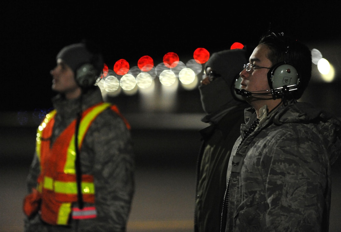 U.S. Air Force Airman 1st Class Andrew Dutton, (left to right), Senior Airman Detroy Brooks and Senior Airman Michael Saulsberry, 509th Aircraft Maintenance Squadron crew chiefs, communicate pre-flight instructions with a B-2 Spirit pilot at Whiteman Air Force Base, Mo., Feb. 2, 2016, during Red Flag (RF) 16-1. The work completed by crew chiefs provides mission-capable aircraft for B-2 pilots so they can provide strike capability, serving a vital role in the overall RF mission. (U.S. Air Force photo by Tech. Sgt. Miguel Lara III)