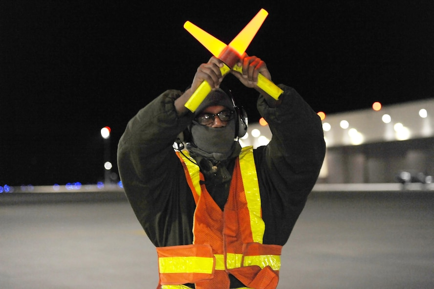 U.S. Air Force Senior Airman Detroy Brooks, a 509th Aircraft Maintenance Squadron crew chief, marshals a B-2 Spirit aircraft at Whiteman Air Force Base, Mo., Feb. 2, 2016. Crew chiefs play a vital role in ensuring traffic safety on the flightline while aircraft taxi before takeoff. (U.S. Air Force photo by Airman 1st Class Michaela R. Slanchik)