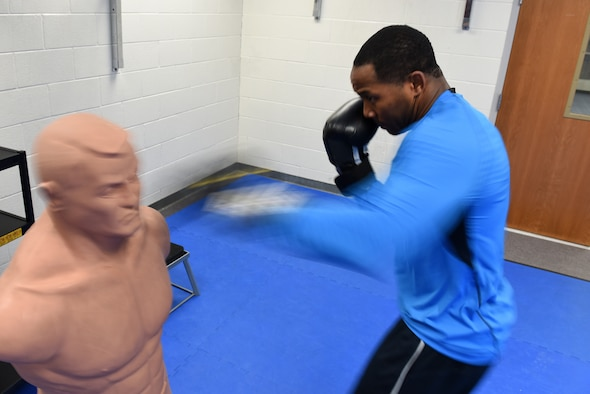 MCGHEE TYSON AIR NATIONAL GUARD BASE, Tenn. - Tech. Sgt. DeAndrew Williams, EPME instructor with the Paul H. Lankford EPME Center, strikes a training dummy to warm up before sparring sessions here Feb. 10, 2016, in Wilson Hall. The I.G. Brown Training and Education Center holds a variety of fitness classes, including the recent boxing class offered by Tech. Sgt. Angelo Gomez. (U.S. Air National Guard photo by Master Sgt. Mike R. Smith/Released)