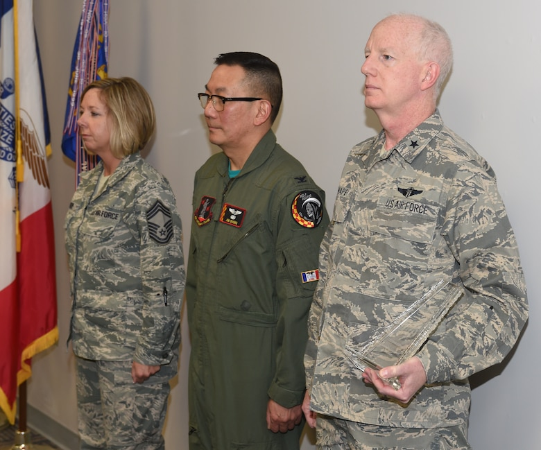 U.S. Air Force Brig. Gen. Christopher Knapp gives Col. Jim Duong and Chief Master Sgt. Kris Rode the 2015 ANG Medical Service Annual Award for Outstanding Achievement in Innovation. (U.S. Air National Guard photo by Staff Sgt. Matthew T. Doyle/Released)
