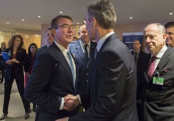 Defense Secretary Ash Carter, left, greets NATO Secretary General Jens Stoltenberg as they meet at NATO headquarters in Brussels, Feb. 10, 2016, to discuss matters of mutual importance. (DoD photo by Air Force Senior Master Sgt. Adrian Cadiz)