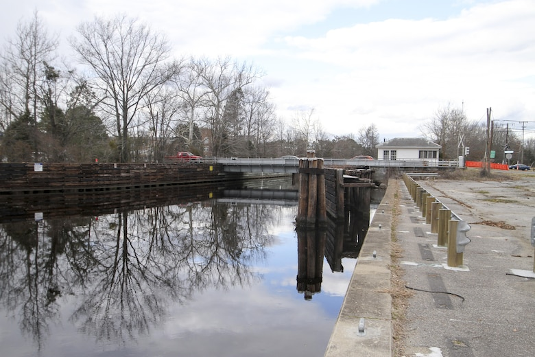 Motorists travel over the Deep Creek Bridge in Chesapeake, Virginia, which spans the Dismal Swamp Canal on February 9, 2016.  $22 million in federal money is identified in the USACE work plan and president's FY 17 budget to go towards replacing the 80 year-old draw bridge. (U.S. Army photo/Patrick Bloodgood)