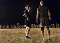 Army Command Sgt. Maj. John W. Troxell, left, senior enlisted advisor to the chairman of the Joint Chiefs of Staff, speaks with Marine Corps Sgt. Maj. Paul McKenna, senior enlisted advisor for U.S. Marine Corps Forces, Pacific , before an early morning physical training session with sailors and Marines at Camp H.M. Smith, Hawaii, Feb. 10, 2016. Troxell worked out with the troops for an hour and then held a brief question and answer session. DoD photo by Navy Petty Officer 2nd Class Dominique A. Pineiro